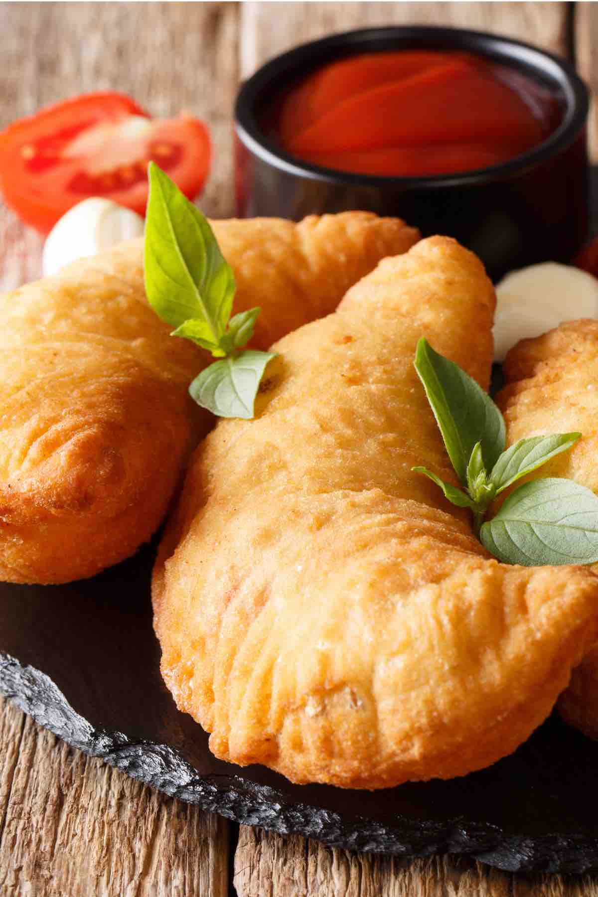 Easy Panzerotti (or Panzarotti) is an Italian savory turnover like a mini pizza pocket and it's super easy to make at home! A pizza dough crust is filled with all the classic toppings – pepperoni, cheese, and your choice of sauce. These semi-circular pockets are then baked or deep-fried to golden perfection. If this sounds like something you might like (how can it not?), check out this authentic recipe.