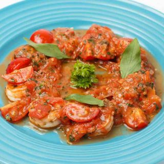 Spanish Shrimp and Chorizo is one of the best Spanish Appetizers. Succulent shrimp and chorizo sausage are cooked in a delicious tomato sauce.