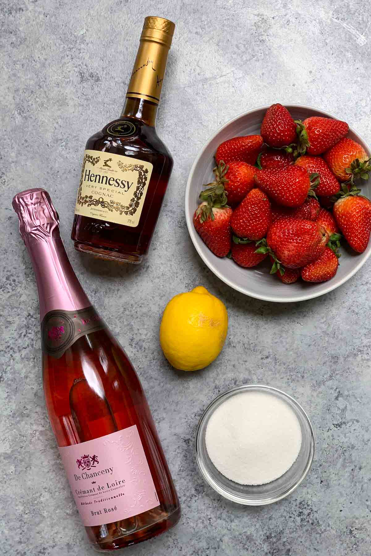 Strawberry Hennessy Drink  ingredients on the counter.