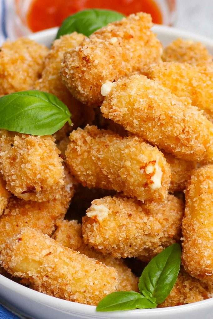 Olive Garden is known for its delectable Italian menu items, including appetizers. For those who want to go beyond breadsticks, this copycat Stuffed Ziti Fritta is crispy, cheesy and packed with flavors. Cooked rigatoni pasta is stuffed with a delicious cheese mixture and then fried to golden perfection!