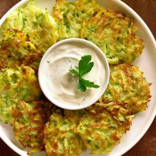 Zucchini Fritters are one of the best zucchini recipes that are easy to make at home. They're crispy and full of flavor!