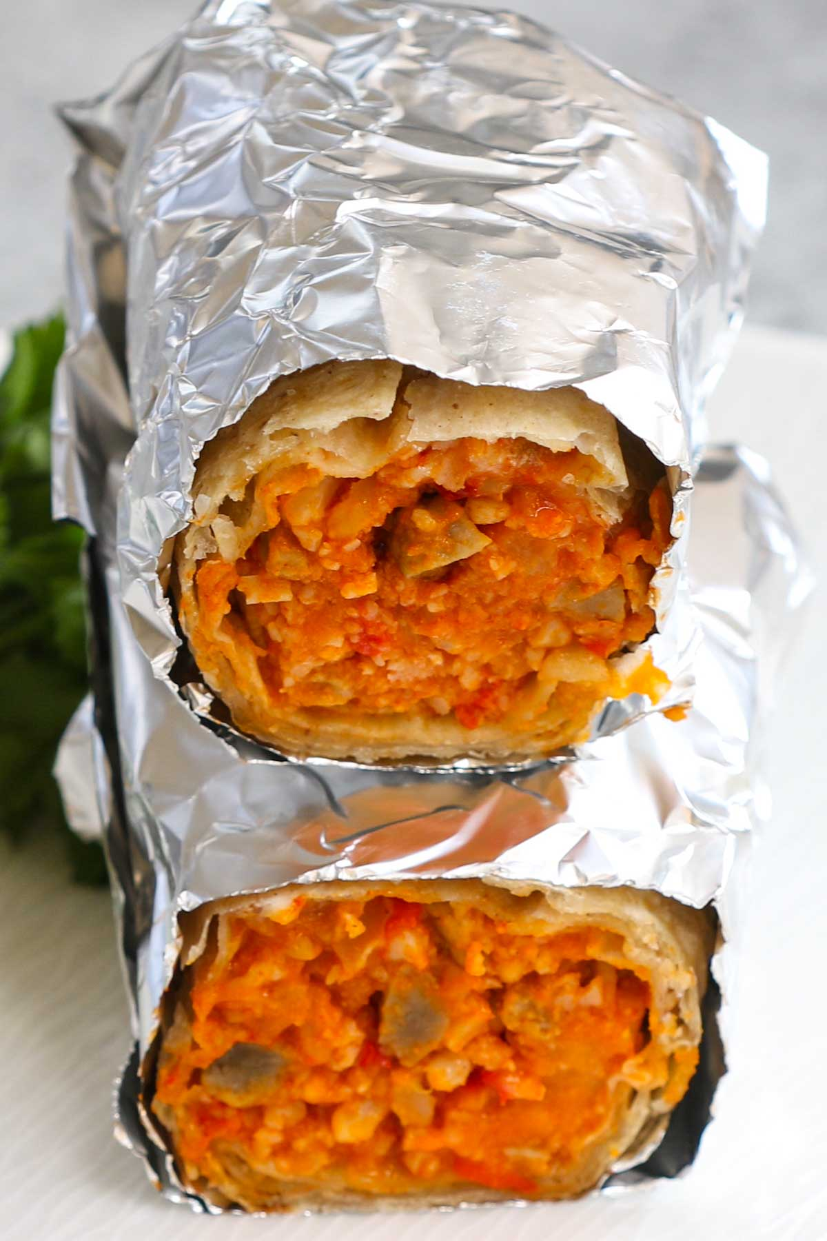 Cooking Frozen Burritos in Air Fryer is the easiest way to prepare a perfect lunch, dinner, or even breakfast. These air fryer frozen burritos are soft and flavorful on the inside and crispy on the outside. You can use this method to cook chimichanga too! Keep some frozen burritos in the freezer and you can satisfy your Mexican food cravings at any time!