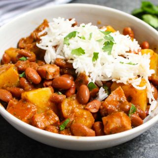 Puerto Rican Rice and Beans are saucy, flavorful, and comforting. Delicious Goya pink beans are simmered in sofrito and tomato sauce with sazon seasoning! This Puerto Rican staple is also known as Habichuelas or stewed beans, and leftovers are perfect for meal prep.