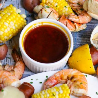 Best Homemade Seafood Boil Sauce is rich, spicy, buttery, and packed with garlic flavor! This seafood butter sauce recipe is easy to make and perfect with your favorite seafood boil, shrimp boil, crawfish boil, and crab boil.
