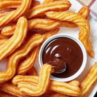 Churros are one of my favorite Spanish desserts. Made with some simple pantry items, they taste like cinnamon donuts!