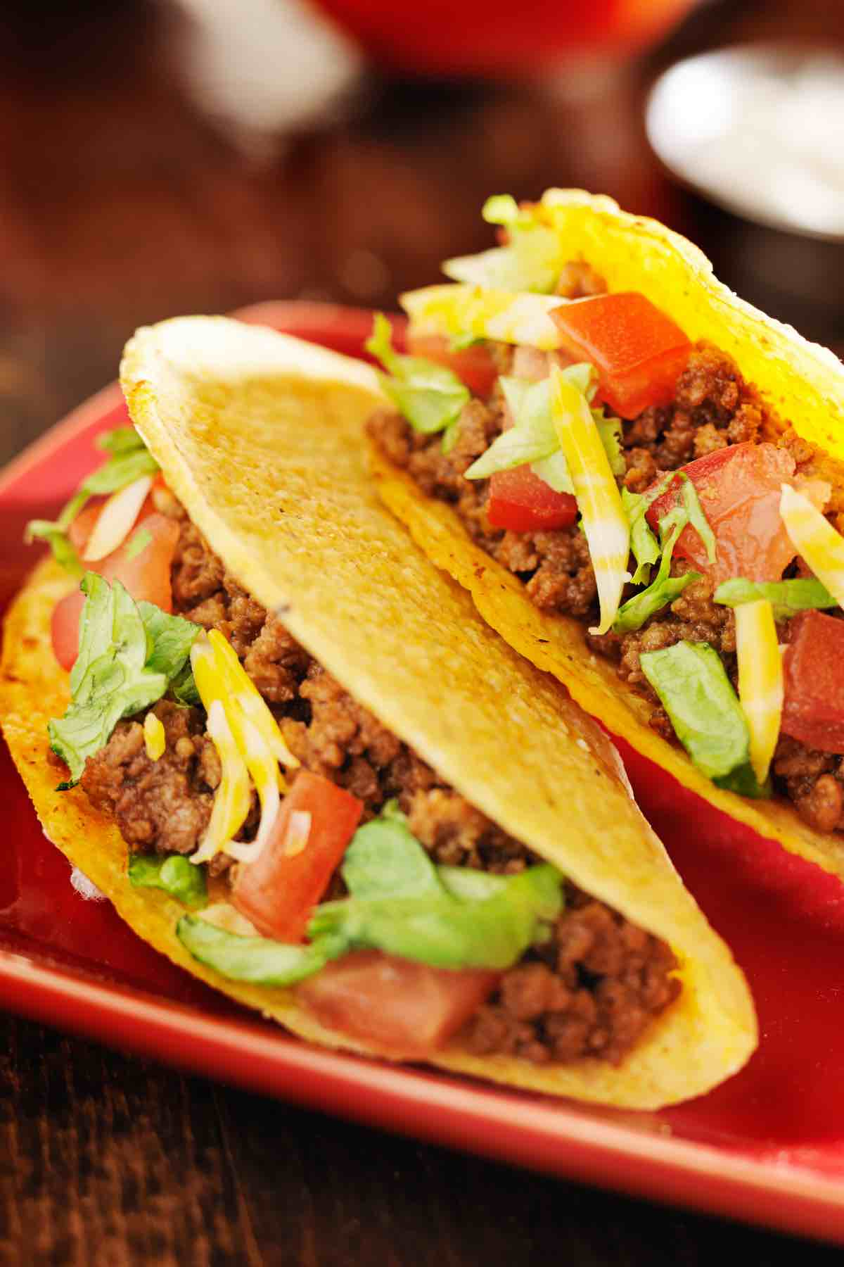 Tacos are one of the most popular Mexican foods. Great Taco Toppings will take your love for tacos to a new level! Great for Cinco De Mayo or Taco Tuesday! We've collected the best taco topping ideas from basic options like guacamole and shredded cheese to chicken, fish, and pork, including ones that are gluten-free and keto-friendly!