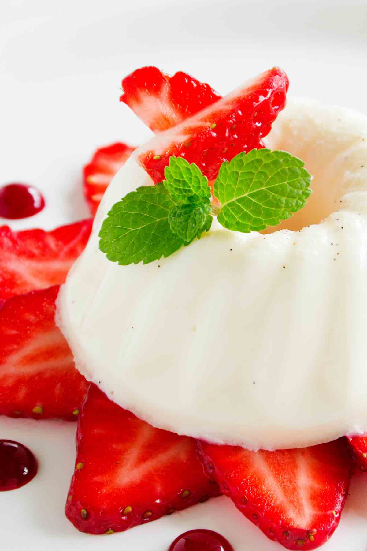 This Blancmange is a light and creamy dessert that can be served on its own or with various toppings, including fresh berries, brown sugar sauce, or cinnamon. I make this recipe every time I need an impressive and quick dessert!