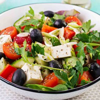 Greek Salad is one of the most popular Greek foods that you can make at home. It's loaded with fresh veggies, olives, and feta.