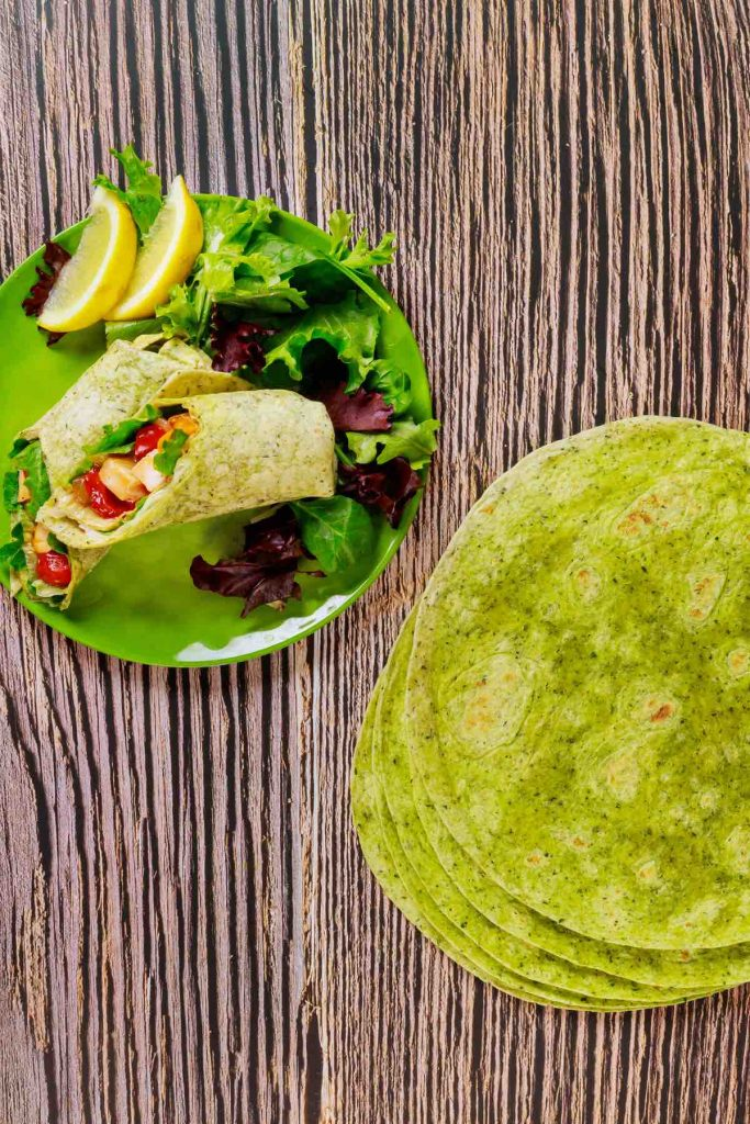 Healthy Spinach Wraps are super easy to make, and perfect for enchiladas, tacos, burritos, and quesadillas. These homemade spinach tortillas are better than the store-bought garden spinach tortilla wraps.