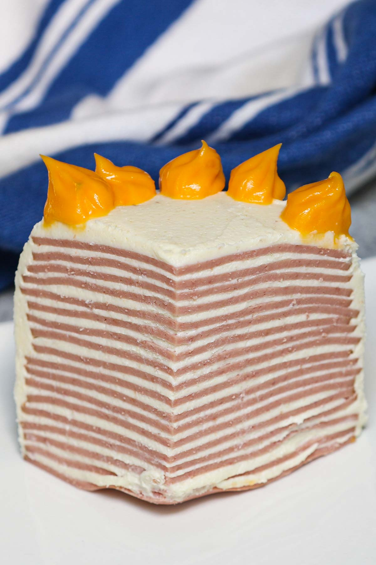 Don't let the name fool you! This isn't a sweet 'cake' for dessert. Bologna Cake is a simple, savory Southern dish, popularly served as an appetizer or side dish at potlucks or family events. You may have heard of this unique meal in Sweet Home Alabama. Whether you're curious or amused, you've got to give this bologna cake recipe a try.
