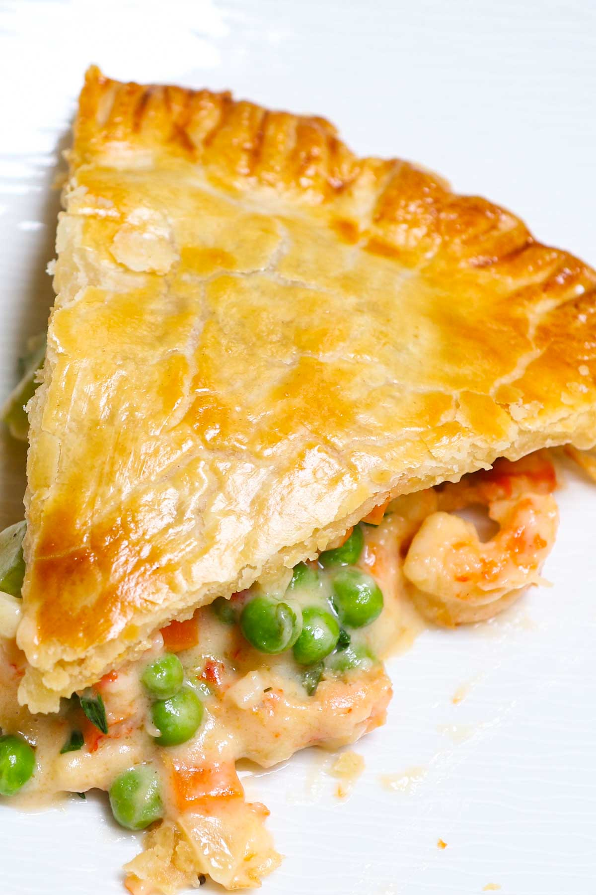 Crawfish Pie is the ultimate comfort food in Louisiana! This famous Cajun dish is a delicious, flaky crawfish pot pie loaded with succulent crawfish tail meat and fresh veggies. It takes just a few ingredients to make a batch at home!