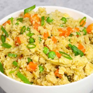 This microwave cauliflower rice is light, fluffy, and full of flavor. It's one of my favorite light dinner recipes and take a few minutes to make.