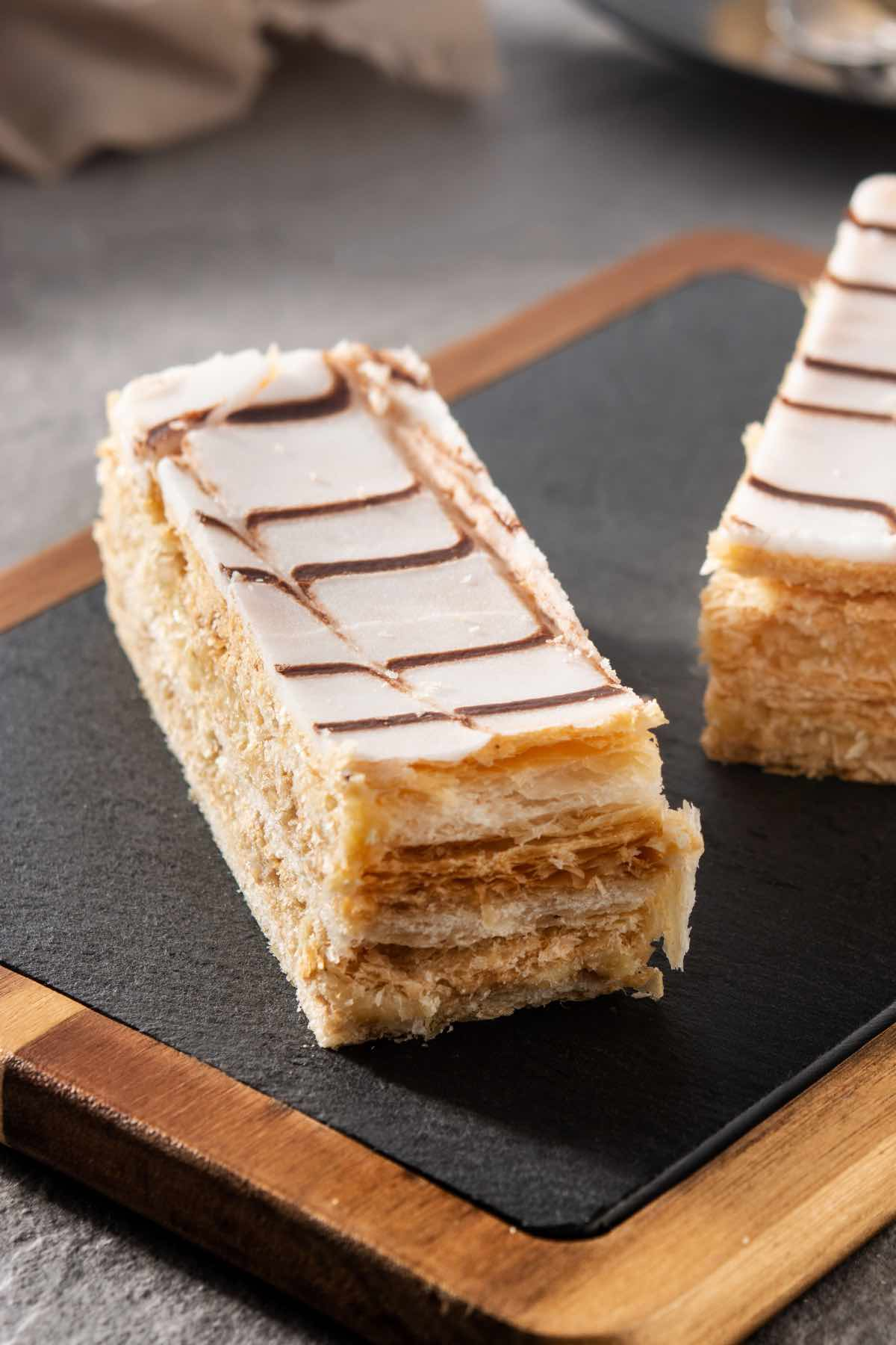 Napoleon Dessert is a classic blend of flaky pastry and creamy filling with a rich yet light taste and texture. Similar to Mile Feuille, it can be paired with tea or coffee for a great afternoon treat or an after-dinner dessert.