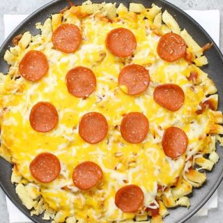 Pepperoni Pizza Fries are loaded with crispy French fry pizza crust and cheesy pepperoni toppings. This is a special pizza you've never had before! It's so easy to make and you can use frozen, freshly cooked, or leftover French fries. Great for a game day party or any fun dinner parties.