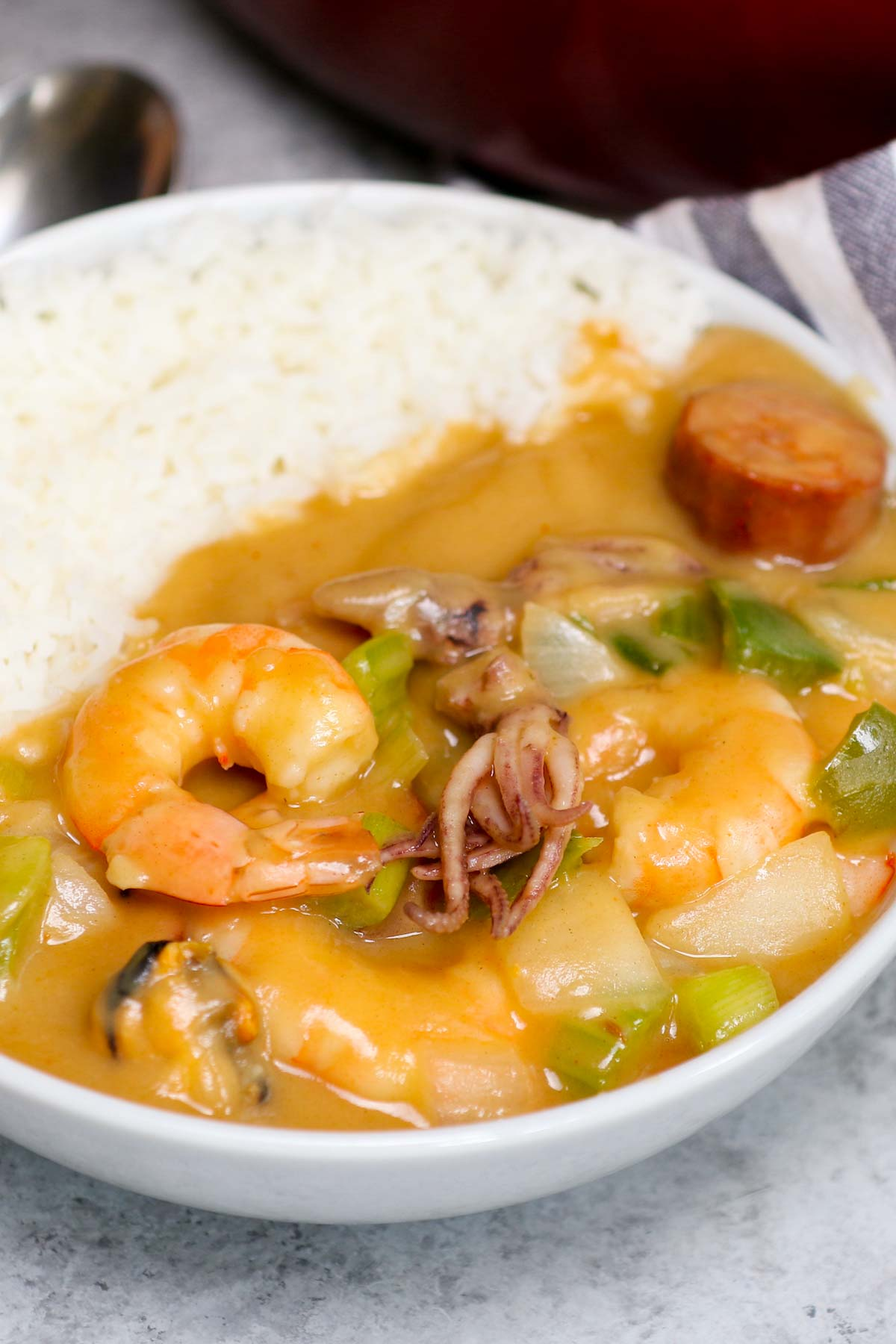This Authentic Louisiana Seafood Gumbo is hearty, comforting, and made with a flavorful roux, mixed seafood, sausage, and vegetables. If you take a trip to New Orleans, you're sure to find gumbo on the menu. Now, you can recreate this delicious gumbo recipe in the comfort of your own home.