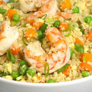 Shrimp Cauliflower Fried Rice is a healthy and light meal that's flavorful and low carb. It will be on your dinner table in under 20 minutes and is one of our favorite frozen shrimp recipes.