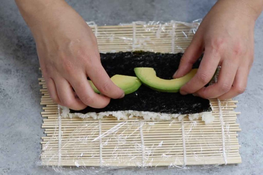 Place avocado slices on top of the seaweed.