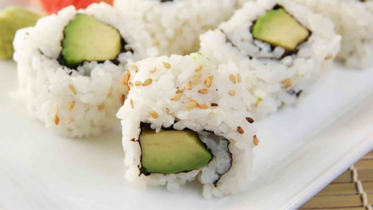 Avocado Sushi Rolls are a vegan variation of the popular California Roll. There's something so satisfying about making your own sushi at home. Not only is it much cheaper than going to a restaurant, it's also a super fun skill to learn! This creamy and delicious avocado roll recipe calls for a few simple ingredients and is easy to make at home.