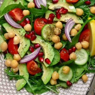 Loaded with garbanzo beans, fresh vegetables, and feta cheese, Chickpea Salad is a healthy dish packed with proteins.