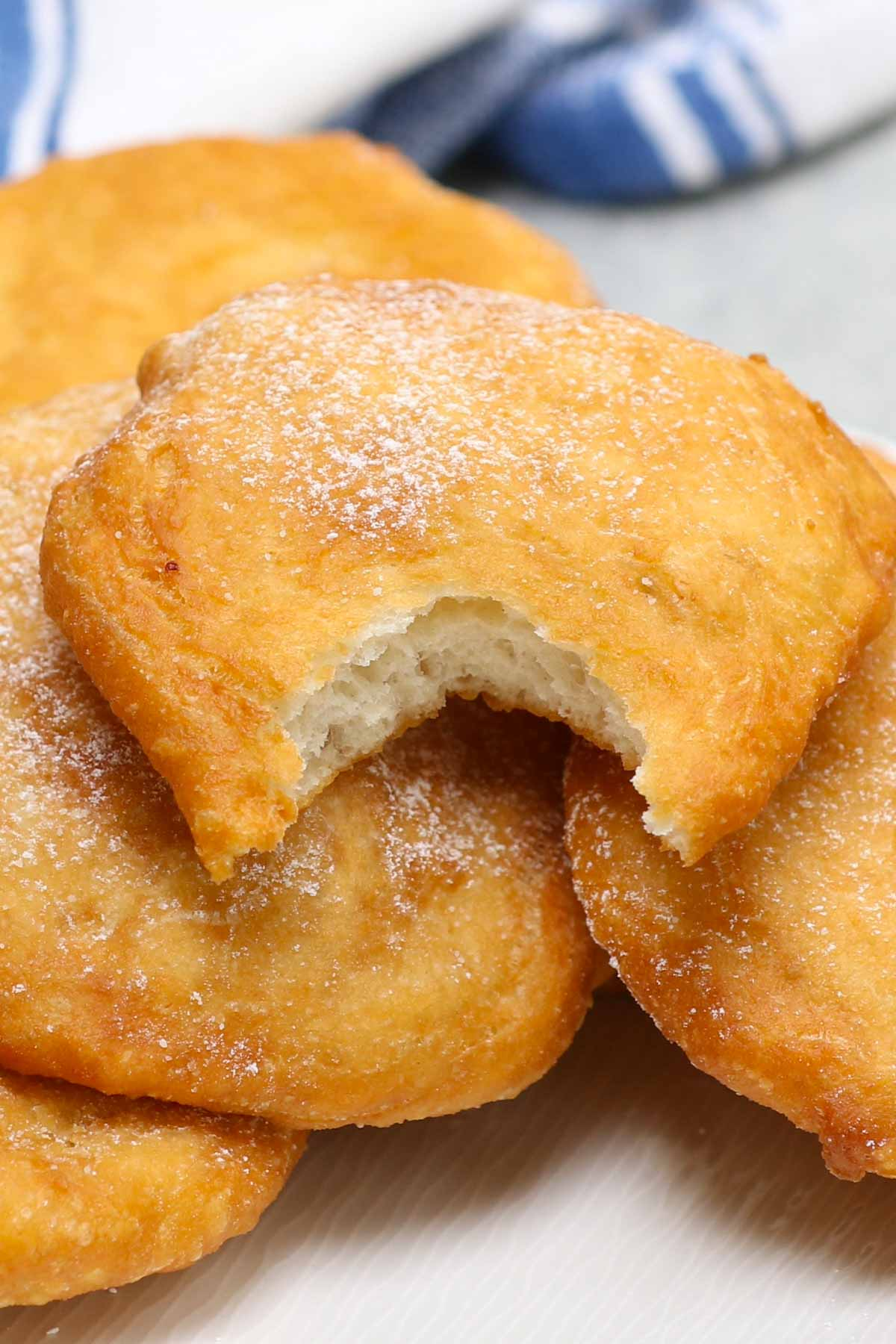 If you want to recreate the experience of a county fair or amusement park at home, there's no easier way than with Fried Dough. This simple treat is a popular street food that is often enjoyed at outdoor activities.