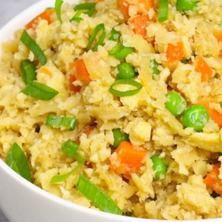 Microwave cauliflower Fried Rice is healthy, delicious, and so easy to make. It's one of our favorite healthy side dishes recipes.