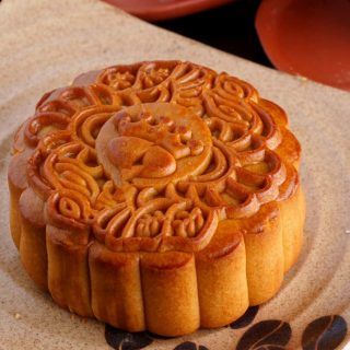 These Chinese Mooncakes are so easy to make at home and taste much better than the store-bought version. It's one of our favorite mooncake recipes for Mid-Autumn Festival.