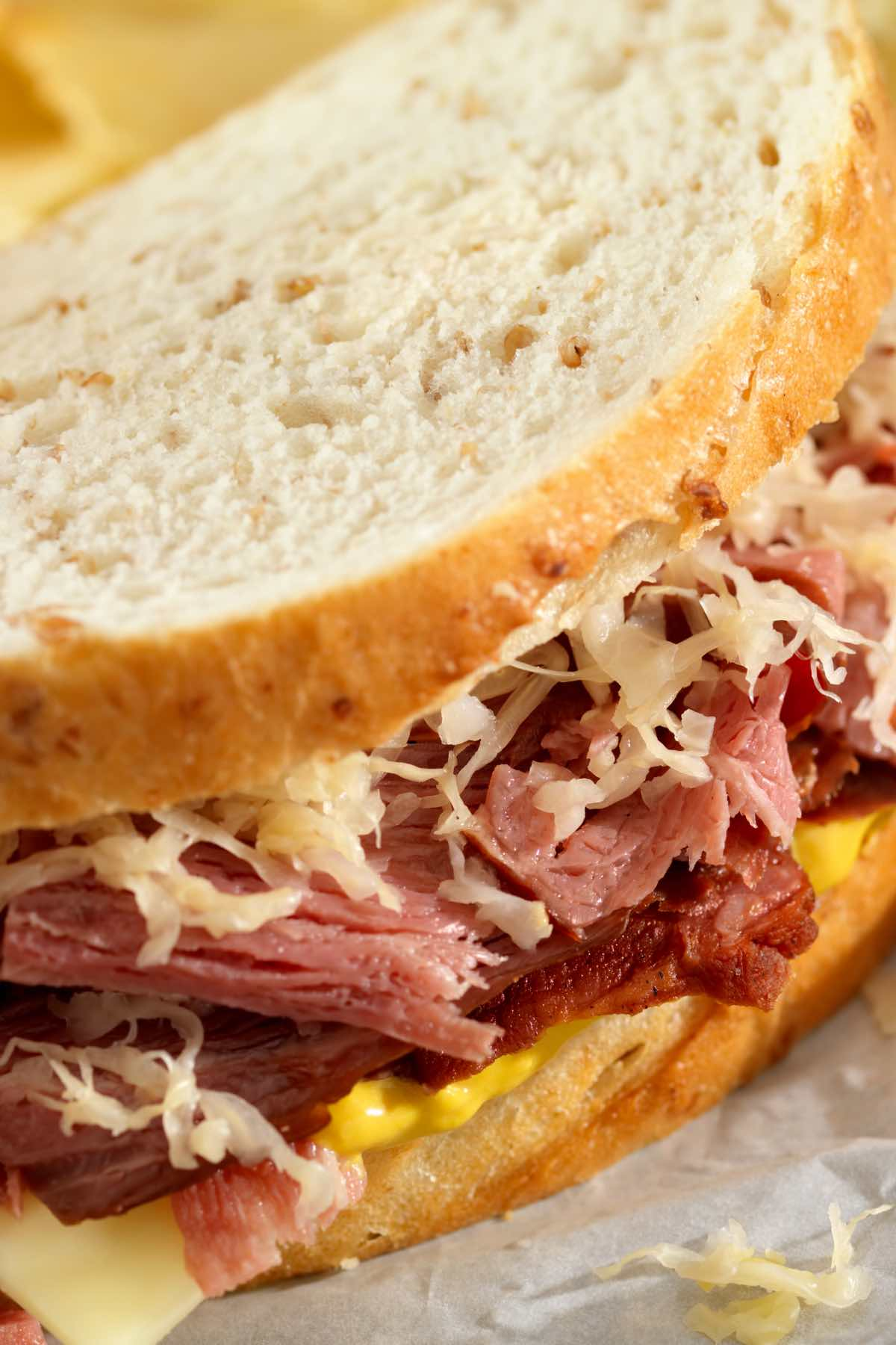 The ultimate Pastrami Sandwich piled high with thinly sliced pastrami, Swiss cheese, and coleslaw. These Artisan sandwiches are perfect for a hearty meal. Serve hot or cold with your favorite fries and veggies!