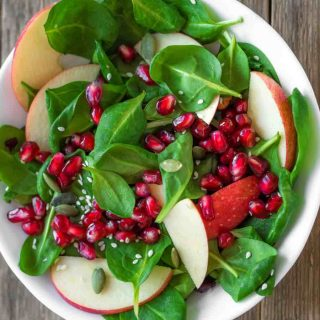Apple Pomegranate Salad is sweet, tart, and full of fall flavors. It's one of my favorite pomegranate recipes and comes together in less than 5 minutes.