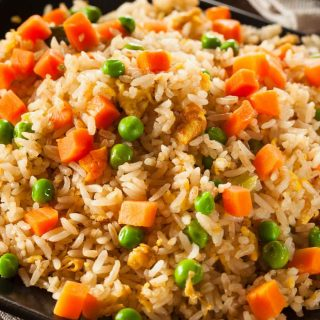 Fried rice is an easy side dish that's loaded with delicious vegetables and scrambled eggs. You can customize it by adding your favorite veggies and proteins.