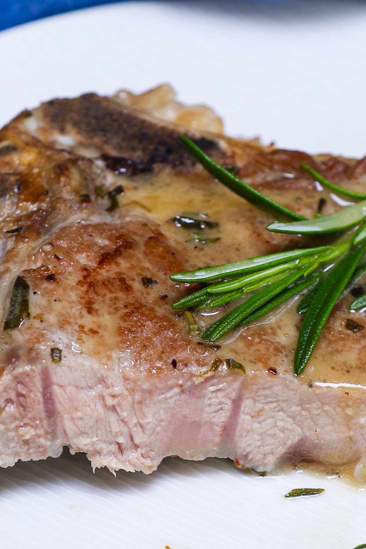 Cross-section view of a veal chop cooked to medium doneness.