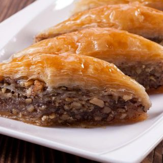 Baklava has flaky phyllo pastry on the outside and sweet, crunchy walnuts on the inside. It's one of our favorite Greek desserts.