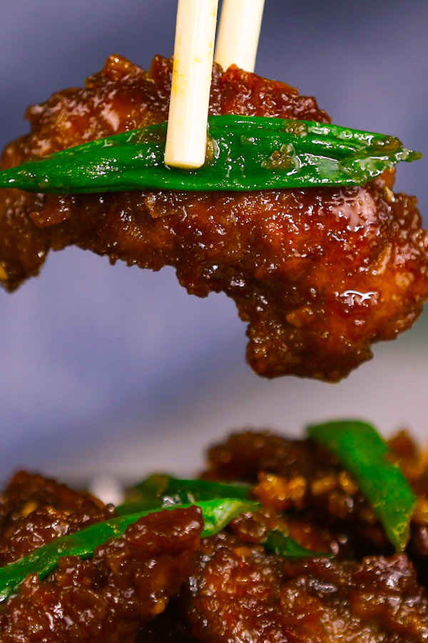 Say goodbye to bland, rubbery steak and say hello to tender and flavorful slivers of Mongolian Shaved Beef Recipe. This easy thinly sliced shaved steak dish is simmered in a sweet and spicy ginger garlic sauce and garnished with fresh green onions.